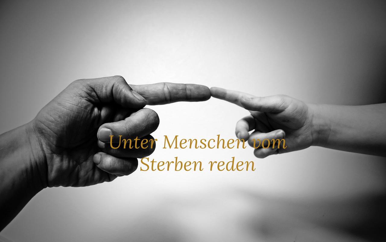 Zwei Zeigefinger berühren sich, Text Unter Menschen vom Sterben reden